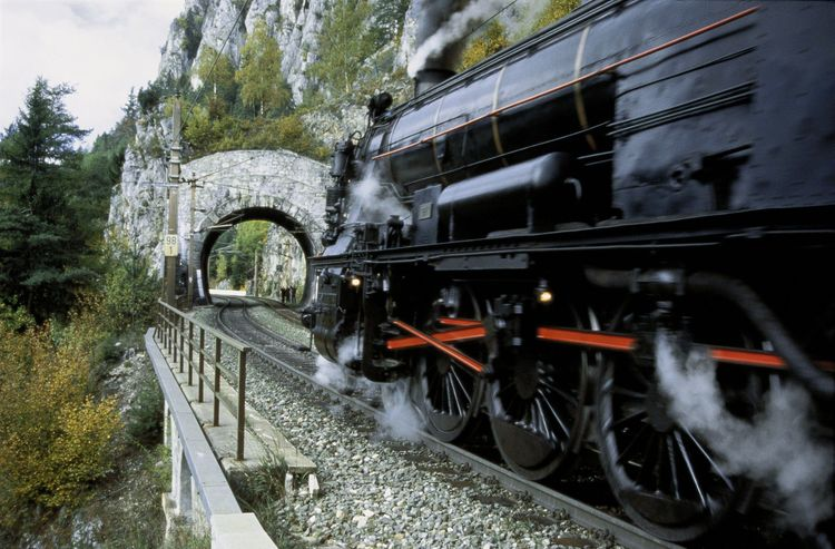 Semmering railway: ancient steamer in front of Krausel tunnel. Semmering, Lower Austria.