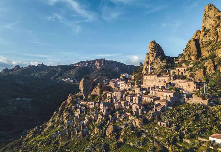 ancient abandoned village called Pentedattilo in Calabria on a mountain