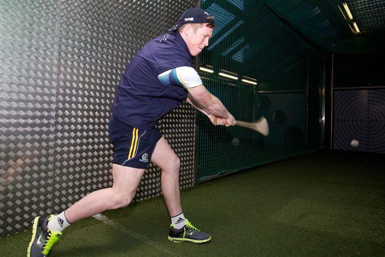 Jack Riewoldt of the AFL Australian International Rules team tries his hand at hurling in the GAA Museum at Croke Park in Dublin, Ireland.