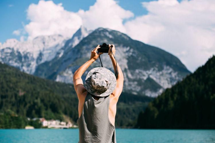 camera-photos-man-landscape-shutterstock_717446542