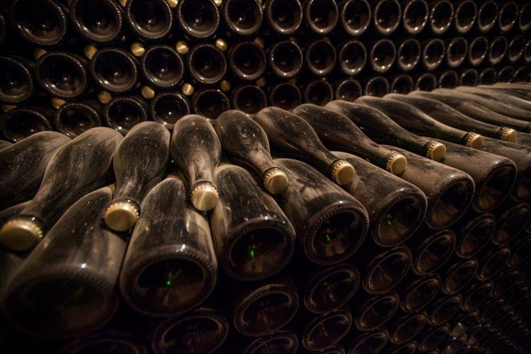 cellar-bottles-champagne-france-shutterstock_1028183404