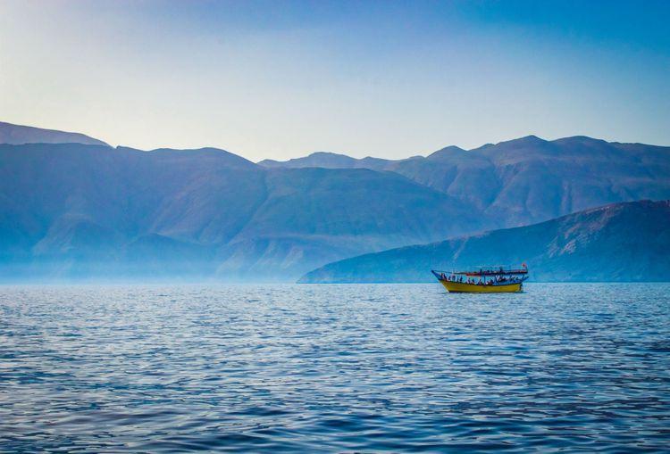 dhow-boat-coast-oman-shutterstock_714636748