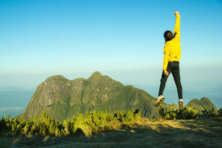 man-jump-mountain-pico-parana-brazil-shutterstock_317976773