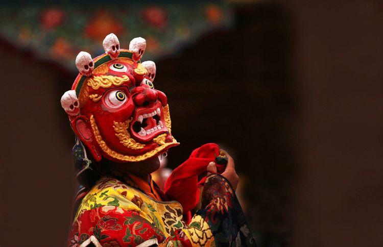 mask-dance-tibet-nepal-shutterstock_705287206