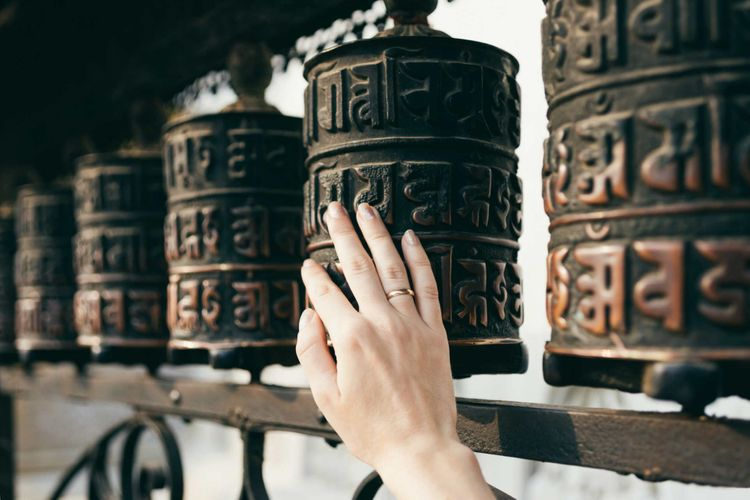 prayer-wheels-buddhist-nepal-shutterstock_1076772620