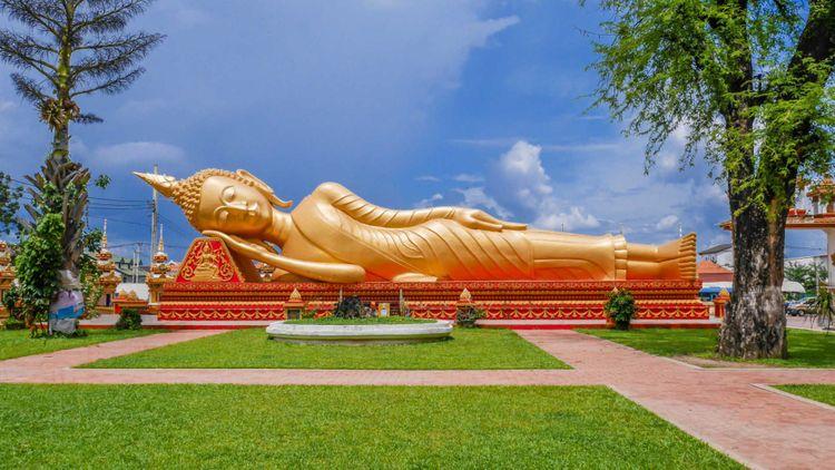Reclining Buddha at Wat Pha That Luang, Vientiane, Laos © Mongkolchon Akesin/Shutterstock