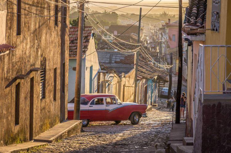 street-old-american-car-cuba-shutterstock_579862594